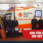 Gruppenbild vor Rettungswagen